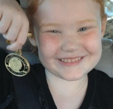 girl_gets_MEDAL-for_helping-Savannah-Woolever-family