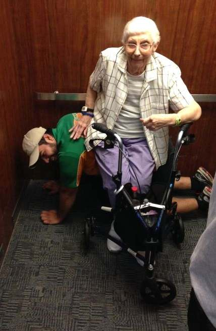mover_acts_as_human_bench_for_elderly_stuck_in_elevator