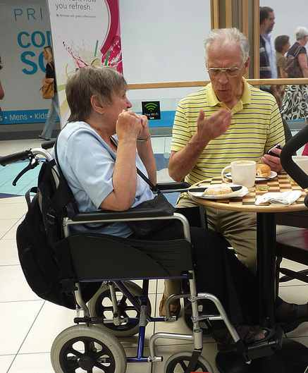 wheelchair_woman_dines_with_man-Ambernecta-CC-Flickr