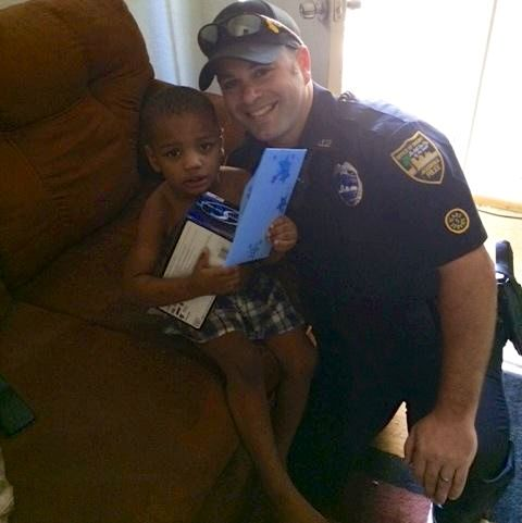 Police_Officer_Derrick_Pratico-with-birthday-boy-FB-photo