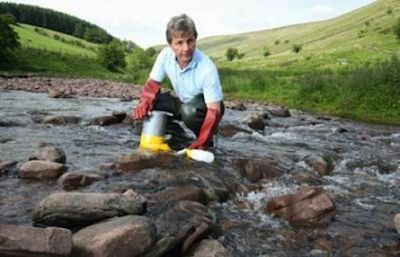 scientist-in-river-Cardiff_University-research