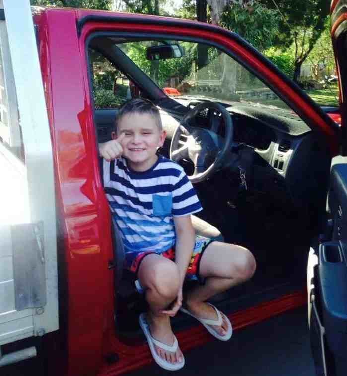 truck-with-boy-thumbs-up-52-lives-dotorg