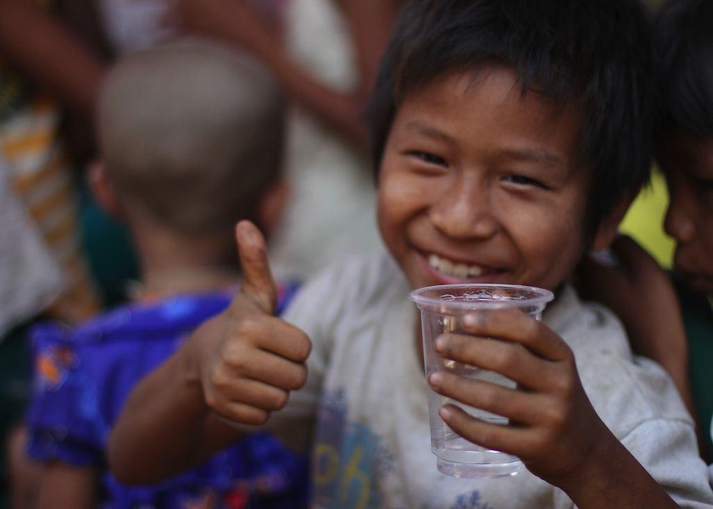 Burma-boy-thumbs-up-for-drinking-water-USAID-Kelly_Ramundo