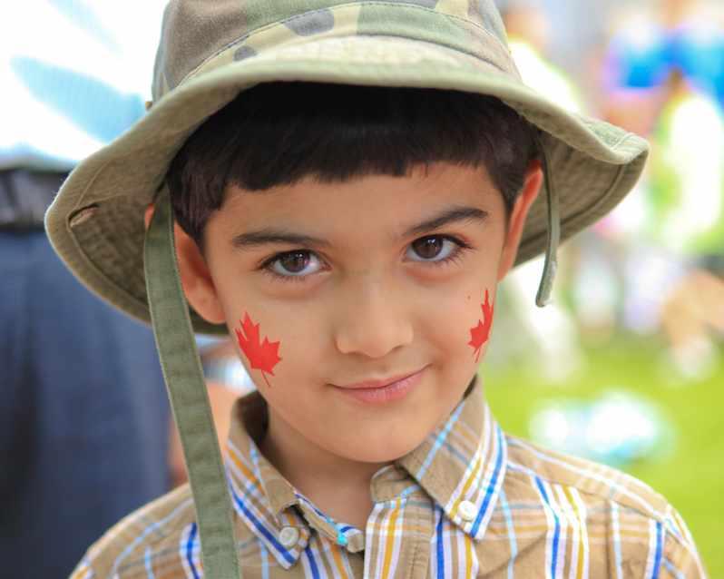 Canada-maple-leaves-on-boys-face-cc-Anirudh_Koul