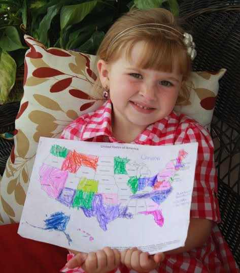 Lilly-Myers-holds_USA-map-for-charity-donations-familyphoto