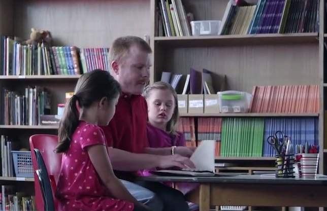 blind-volunteer-Jeff-Balek-in-classroom-reading-YMCAvideo