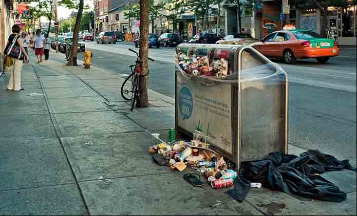 garbage-can-on-city-street-Sam_Javanrouh-CC-Flickr