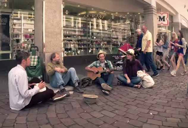 homeless-with-musicians-playing-sidewalk