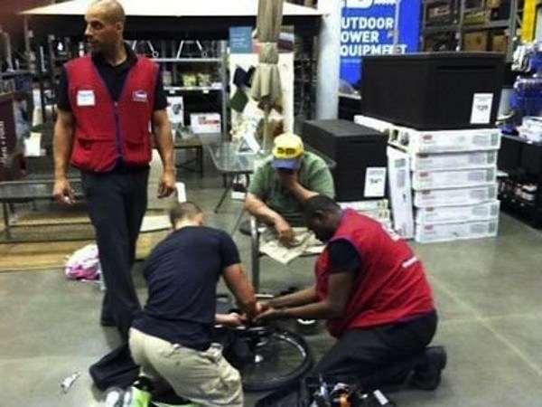 shop-workers-fix-wheelchair-for-vet-familyphoto-Freda_Sulsona