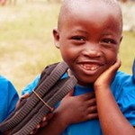 African-boy-gets-new-shoes-from-TOMS