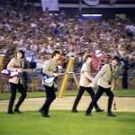 Beatles-take-field-at Shea-1965-fairuse