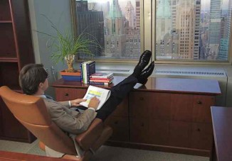 businessman-feet-up-on-desk-relax-stress-MConnors-Morguefile