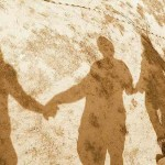 sillouettes-holding-hands-family-cc-Justice_Beitzel