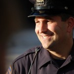 smiling-police-officer-cc-PeterMartinHall