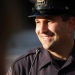 smiling-police-officer-cc-PeterMartinHall