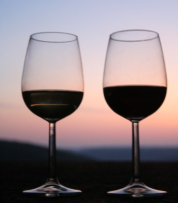 wine-glasses-sunset-Morguefile-MarcoMaru