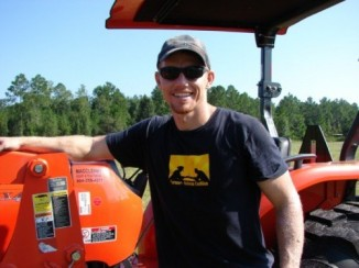 young-farmer-former-soldier-with-tractor-GroundOperations