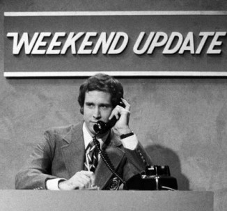 "In this Oct. 11, 1975 photo released by NBC, Chevy Chase performs during a ""Weekend Update"" sketch on ""Saturday Night Live,"" in New York. The long-running sketch comedy series will celebrate their 40th anniversary with a 3-hour special airing Sunday at 8 p.m. EST on NBC. (AP Photo/NBC, Herb Ball)"