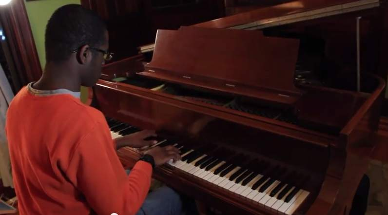 Autistic Justin Brown Plays Piano-RutgersU-submitted