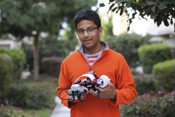 Shubham Banerjee, founder of Braigo Labs Inc., holds a printer in Palo Alto