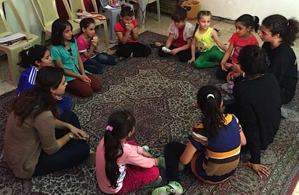 Syrian-refugee-girls-sitting-in-circle-Collateral Repair Project