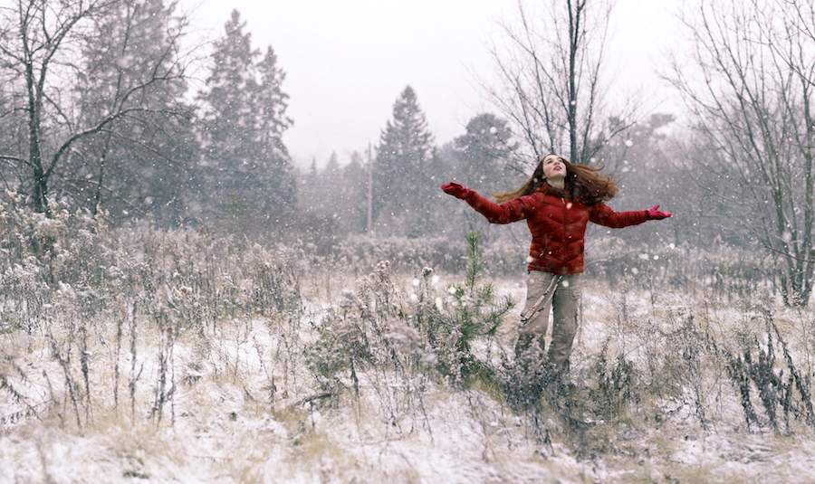 girl gives thanks in snow-CC-Shena Tschofen-900px