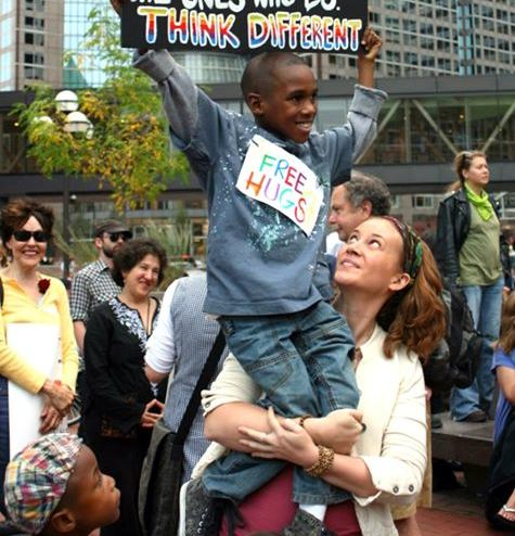 devonte-hart-family photo free hugs sign