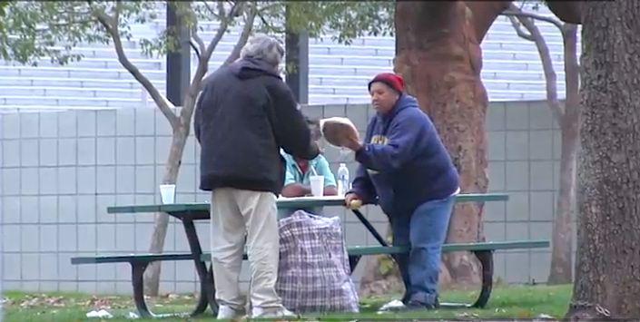 homeless-hands-out-treats-to-strangers-JoshPalerLin