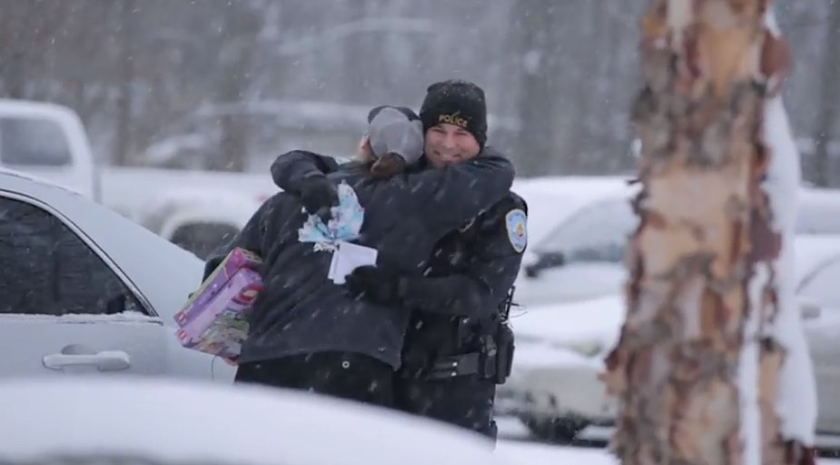 hug in snow for Lowell cop-750px