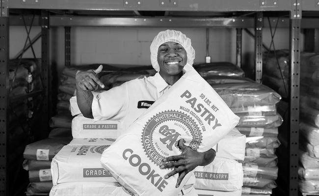 Greyston-bakery-Yonkers-smiling employee B+WphotoFB