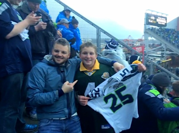Seattle fan gives shirt off back to kid-McElravyFamilyPhoto-FB