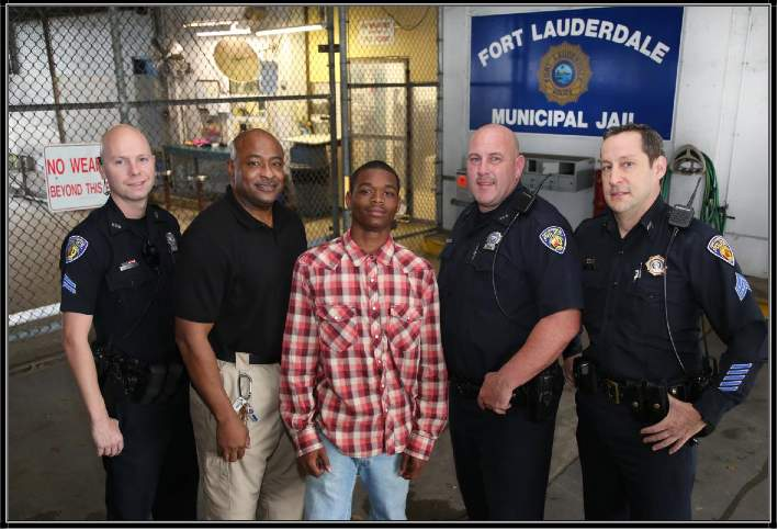 arrested Florida teen saves officer