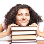 college student smiling with books-cc-CollegeDegrees360