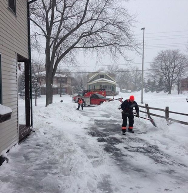 Greenfield FireDept shovels snow-FBPage