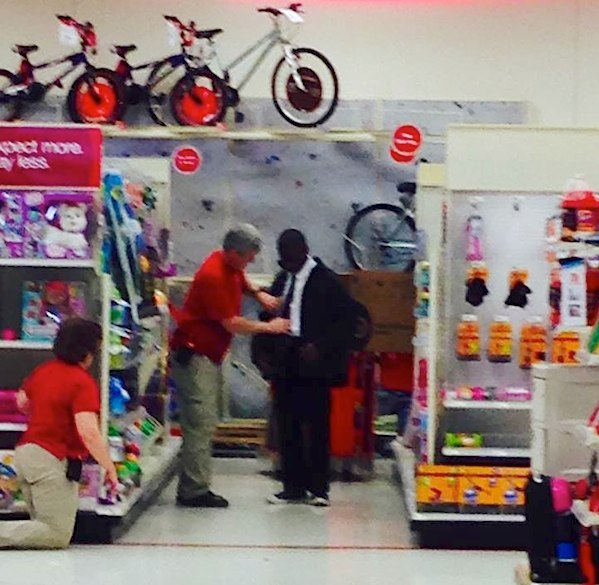 target-employee-helps-youth-with-tie-AudreyMarkFBPhoto