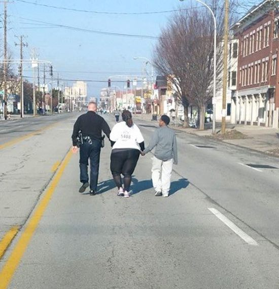 policeman helps 10k runner-FB-Daniel_Carlton_Jr