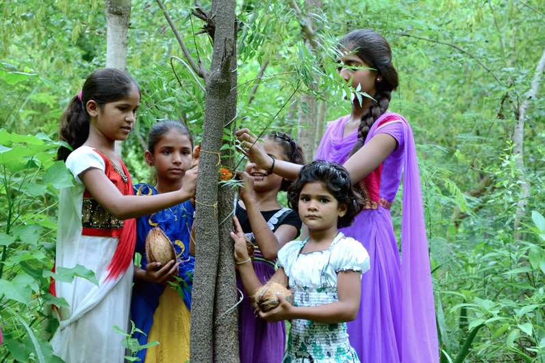 India-family-girls-plant 111 trees