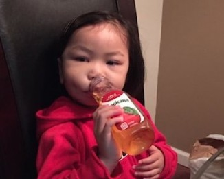 After surgery, Kaitlin Nguygen enjoys juice