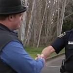 police Lt David Natt shakes hand-KMTRvideo