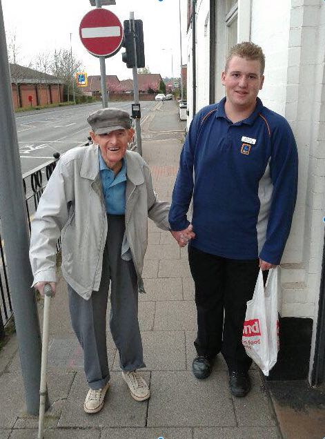 youth carries groceries for elderly-FB-SamanthaBrady