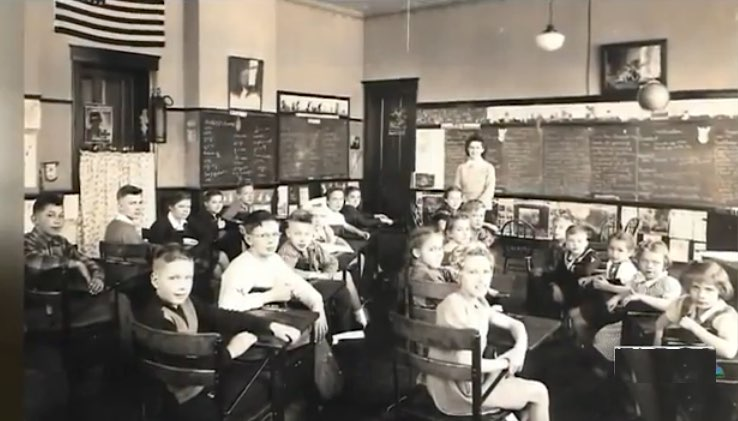 Old classroom in sixties-teacher