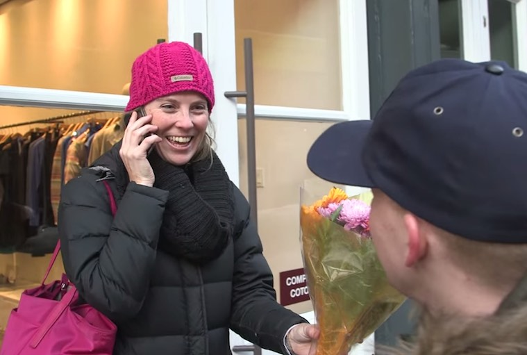 woman-gets-flowers-on-street-on-phone-submitted-NylonDotCom