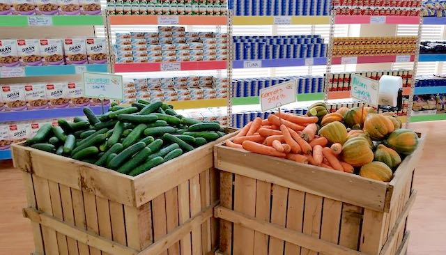 cucumbers-carrots-in-grocery-bin-DailyTable-FB