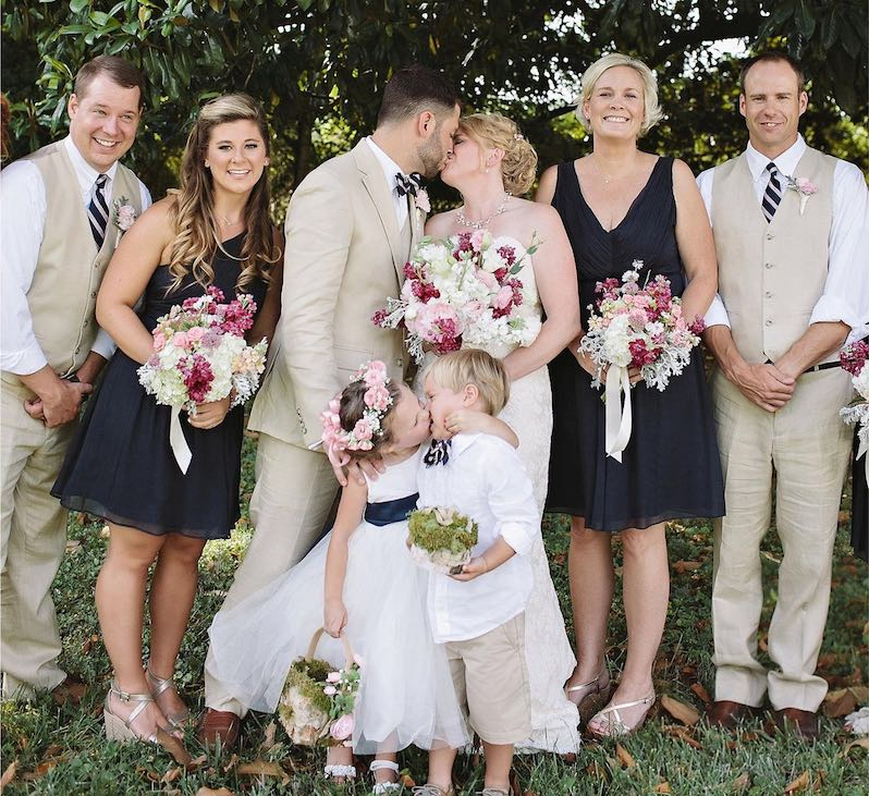 flowerl girl kisses ring bearer-copyright-Leah Bullard Photography-released