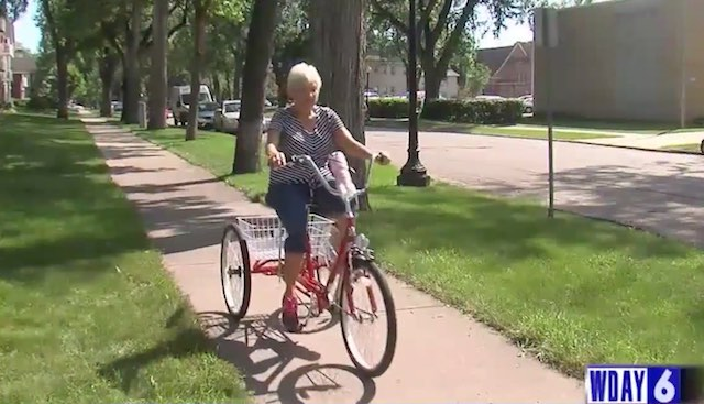 79yo-Dolly Juelke-on-tricycle-WDAYvideo