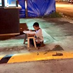 Boy studying on street Facebook