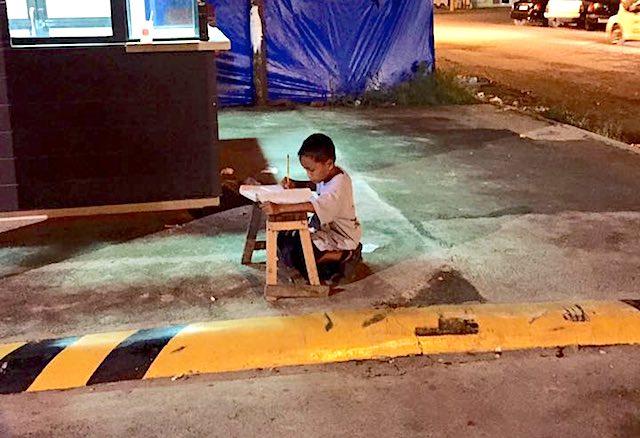 Boy studying on street Facebook