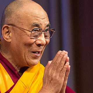 Dalai Lama praying hands cc Christopher.Michel
