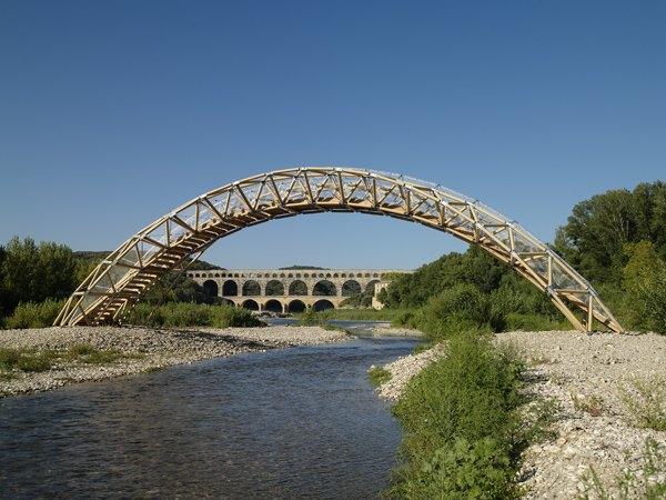 ultra strong bridge made of cardboard inspires shelter design