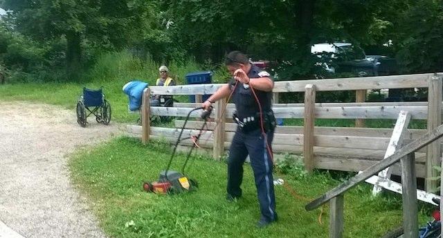 cop mows lawn Downtown Kalamazoo Cops facebook